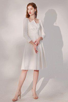 Elegant Pleated White Knee...
