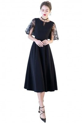 Chic Black Midi Party Dress...